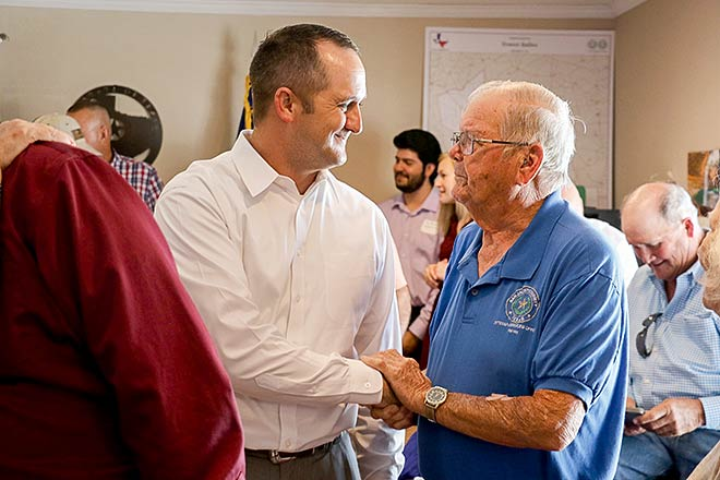Rep. Ernest Bailes shakes the hand of a community member during the open house of his district office in Shepherd on Thursday, July 13. (Megan Whitworth/San Jacinto News-Times)