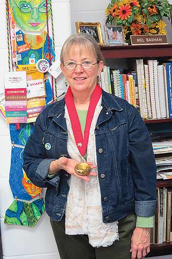 Shepherd art teacher Mel Basham selected as a TAEA Distinguished Fellow.