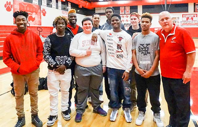 "The Coldspring Trojan basketball team helped make Splendora senior Zach Mills' dream come true during the game against Splendora on Tuesday, Feb. 9. Pictured from left to right, back row:  Edward Hayes, Cadarrius ""Tunk"" Harrison, Ave-on ""Red"" Gilbert, and Brett Lewis; front row: Anthony Richard, Terrance Griffin, Zach Mills (Splendora), Trey Cole, Baxter Smith and Coach Devers. (Photo by Jason Vela)"